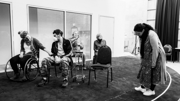 The cast and creative team in rehearsal