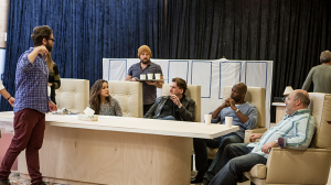 Director Sam Strong with members of the cast in rehearsals for The Speechmaker at MTC