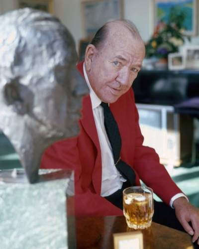 Noel_Coward_with_Bust_Allan_Warren English Sir Noel Coward with his bust in his sitting room in Les Avants Switzerland 1972.jpg