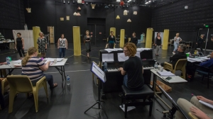 The cast and creative team in rehearsals
