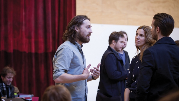 Simon Stone speaks with actors Katherine Tonkin and David Paterson during rehearsals for The Cherry Orchard.